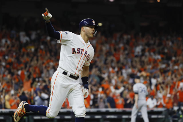 Houston Astros' Carlos Correa celebrates with teammates after his walk-off home run against the New York Yankees during the 11th inning in Game 2 of baseball's American League Championship Series Sunday, Oct. 13, 2019, in Houston. (AP Photo/Matt Slocum)