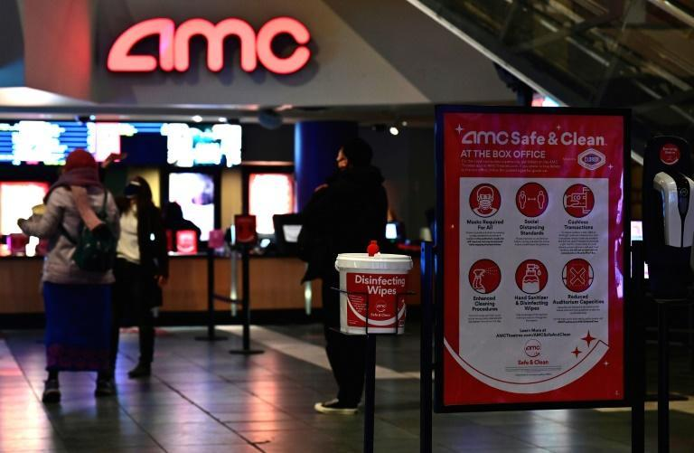 Moviegoers stand in line at AMC Empire 25 off Times Square as New York City's cinemas reopened on March 5, 2021, a year after they were closed by coronavirus