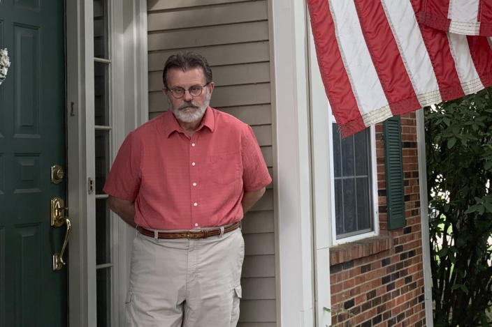 Richard Dayton stands in front of his house as he poses for a photograph, Friday, July 17, 2020, in Columbus, Ohio. State and local election officials across the country are trying to recruit younger workers to staff polling places on Election Day in November. The effort is driven by concern that many traditional poll workers will be too worried about catching the coronavirus to show up. (AP Photo/Farnoush Amiri)