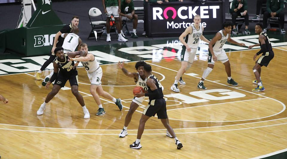 In the post, Michigan State Spartans forward Thomas Kithier defends Purdue Boilermakers forward Trevion Williams during the first half at Breslin Center in East Lansing, Friday, Jan. 8, 2021.