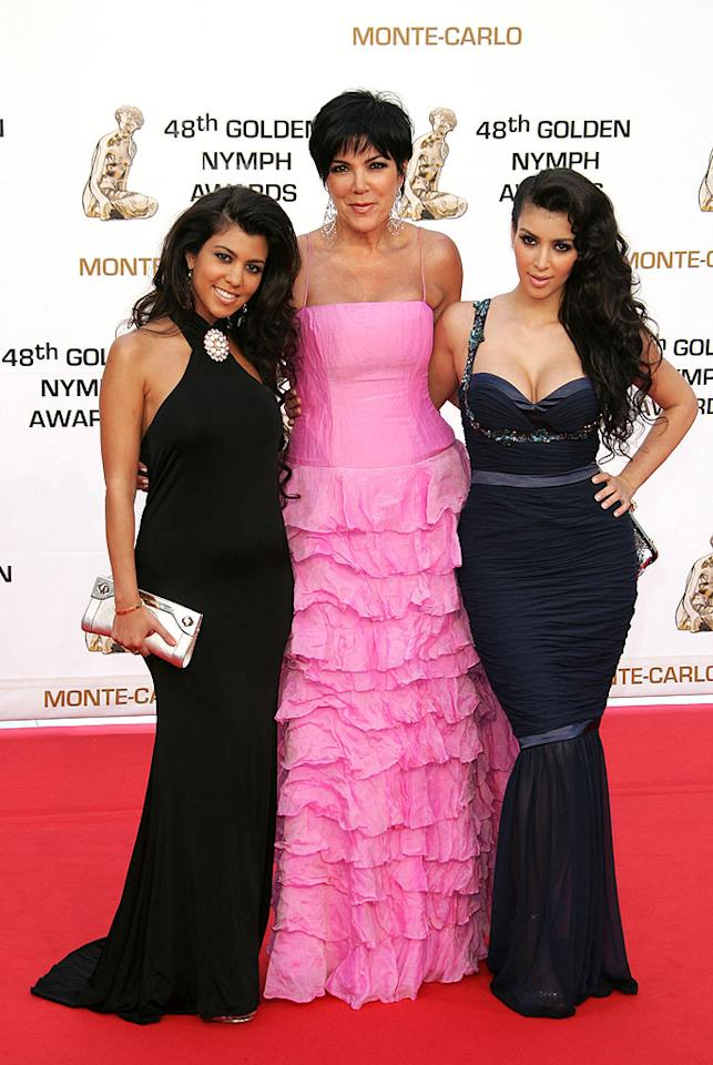 """Kris Kardashian brightens up the red carpet in a Pepto-Bismol pink ruffled gown, while her daughters Kourtney and Kim show off their curves in black and blue. Tony Barson/<a href=""""http://www.wireimage.com"""" target=""""new"""">WireImage.com</a> - June 12, 2008"""