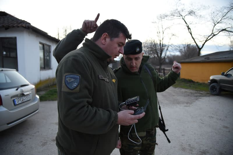 A Greek soldier flies a drone, to spot migrants and refugees crossing from Turkey into Greece, near the village of Marasia