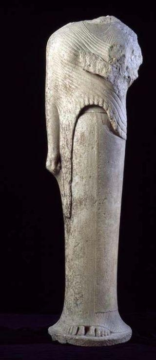 A photograph of a female statue missing its head and one of its arms.