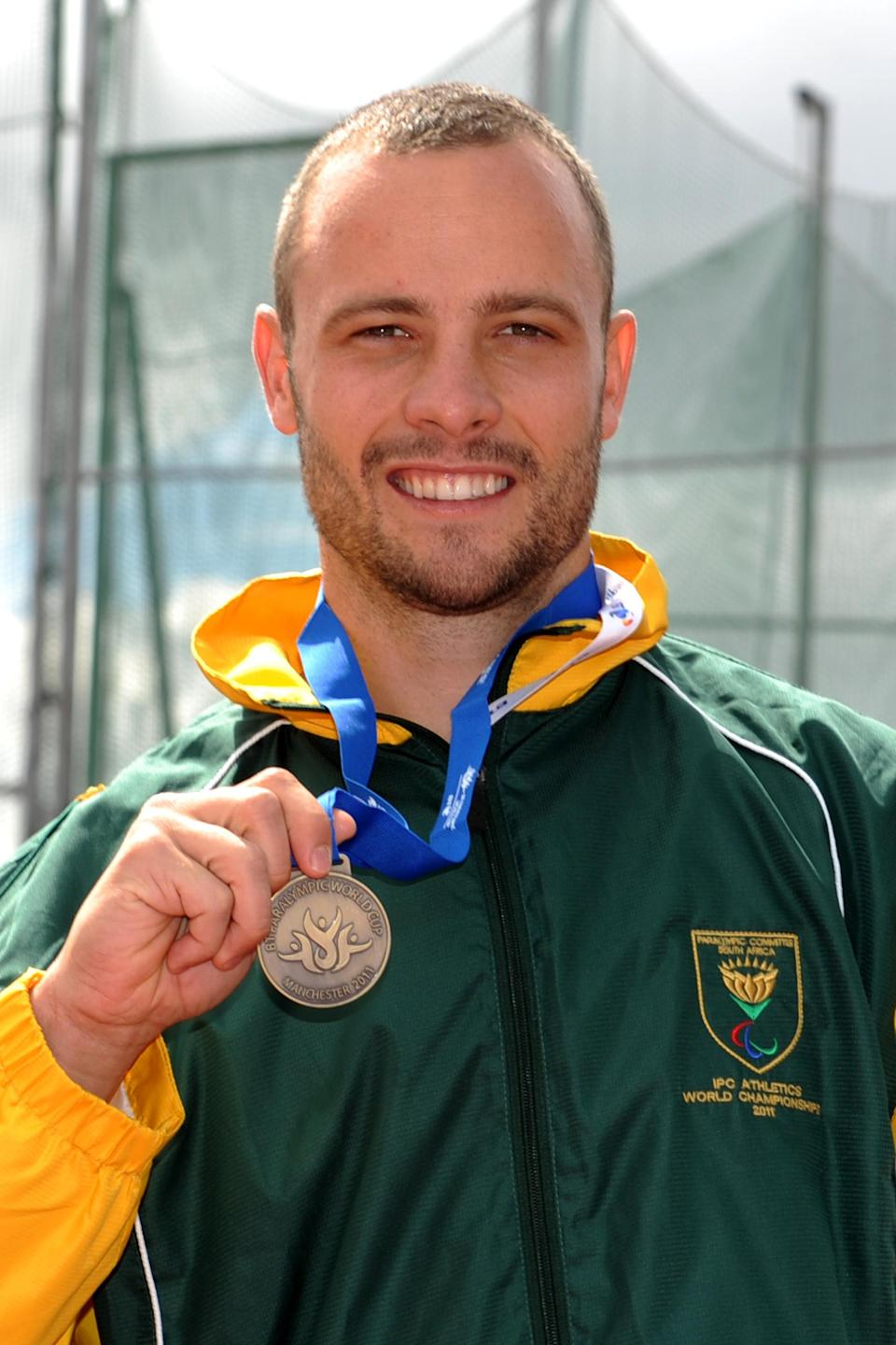 South Africa's Oscar Pistorius celebrates with his Gold medal after winning the Men's T44 100m during the Paralympic World Cup in Manchester.