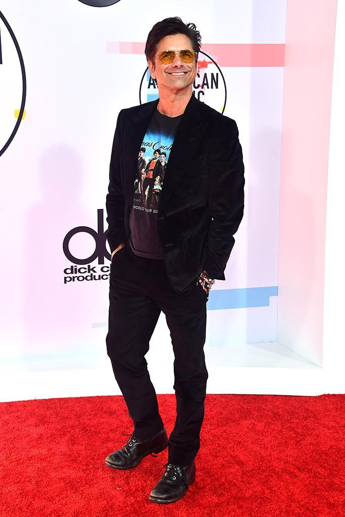 <p>Music lover John Stamos rocked a Jonas Brothers T-shirt under his velvet blazer. As cool as always… (Photo: Frazer Harrison/Getty Images) </p>