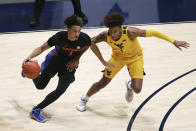 FILE - In this Jan. 30, 2021, file photo, Florida guard Tre Mann (1) is defended by West Virginia guard Miles McBride (4) during the first half of an NCAA college basketball game in Morgantown, W.Va. Mann is considered one of the top point guards in the NBA draft after blossoming as a sophomore at Florida.(AP Photo/Kathleen Batten)