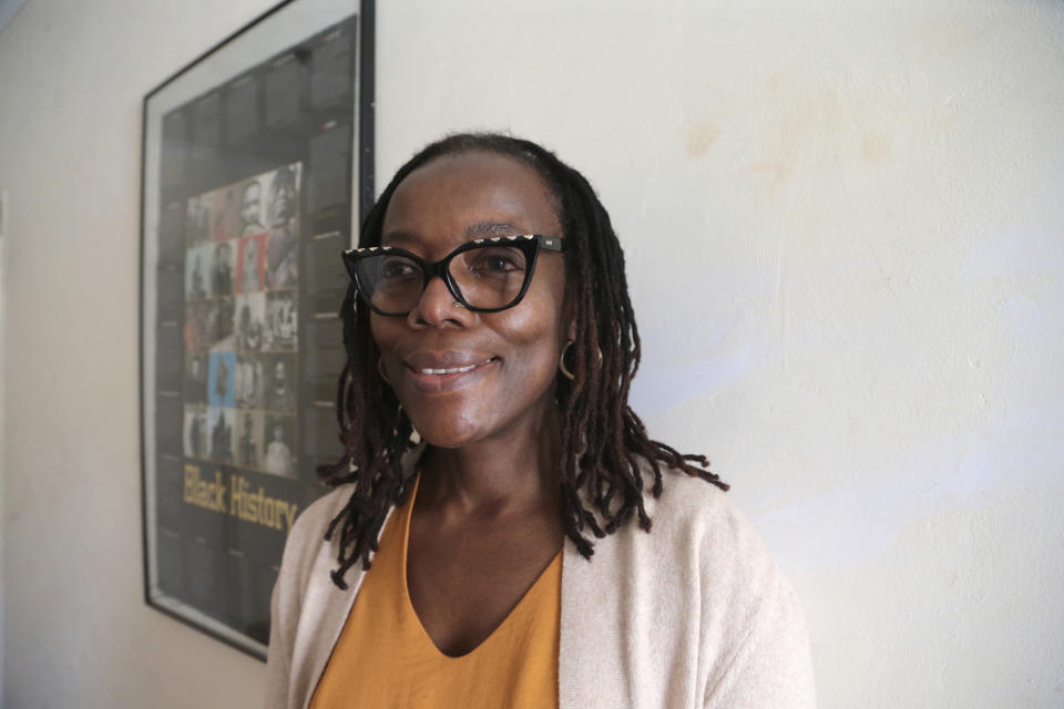 Zimbabwean author Tsitsi Dangarembwa poses for a photograph, at her home in Harare, Tuesday, June 22, 2021. The Peace Prize of the German Book Trade, which is endowed with 25,000 euros ($29,700), has been awarded since 1950. Dangarembga will receive it in Frankfurt on Oct. 24. (AP Photo/Tsvangirayi Mukwazhi)