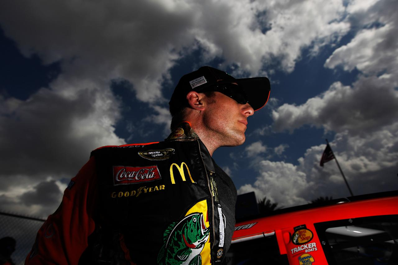 DAYTONA BEACH, FL - FEBRUARY 19:  Jamie McMurray, driver of the #1 Bass Pro Shops/Tracker Boats Chevrolet, looks on after qualifying for the NASCAR Sprint Cup Series Daytona 500 at Daytona International Speedway on February 19, 2012 in Daytona Beach, Florida.  (Photo by Tom Pennington/Getty Images for NASCAR)