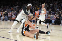 Chicago Sky forward Kahleah Copper (2) and Phoenix Mercury guard Sophie Cunningham (9) compete for a loose ball during the first half of Game 2 of basketball's WNBA Finals, Wednesday, Oct. 13, 2021, in Phoenix. (AP Photo/Rick Scuteri)