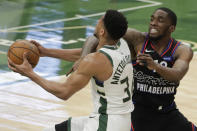 Milwaukee Bucks' Giannis Antetokounmpo is fouled as he drives to the basket against Philadelphia 76ers' Shake Milton during the second half of an NBA basketball game Thursday, April 22, 2021, in Milwaukee. (AP Photo/Aaron Gash)