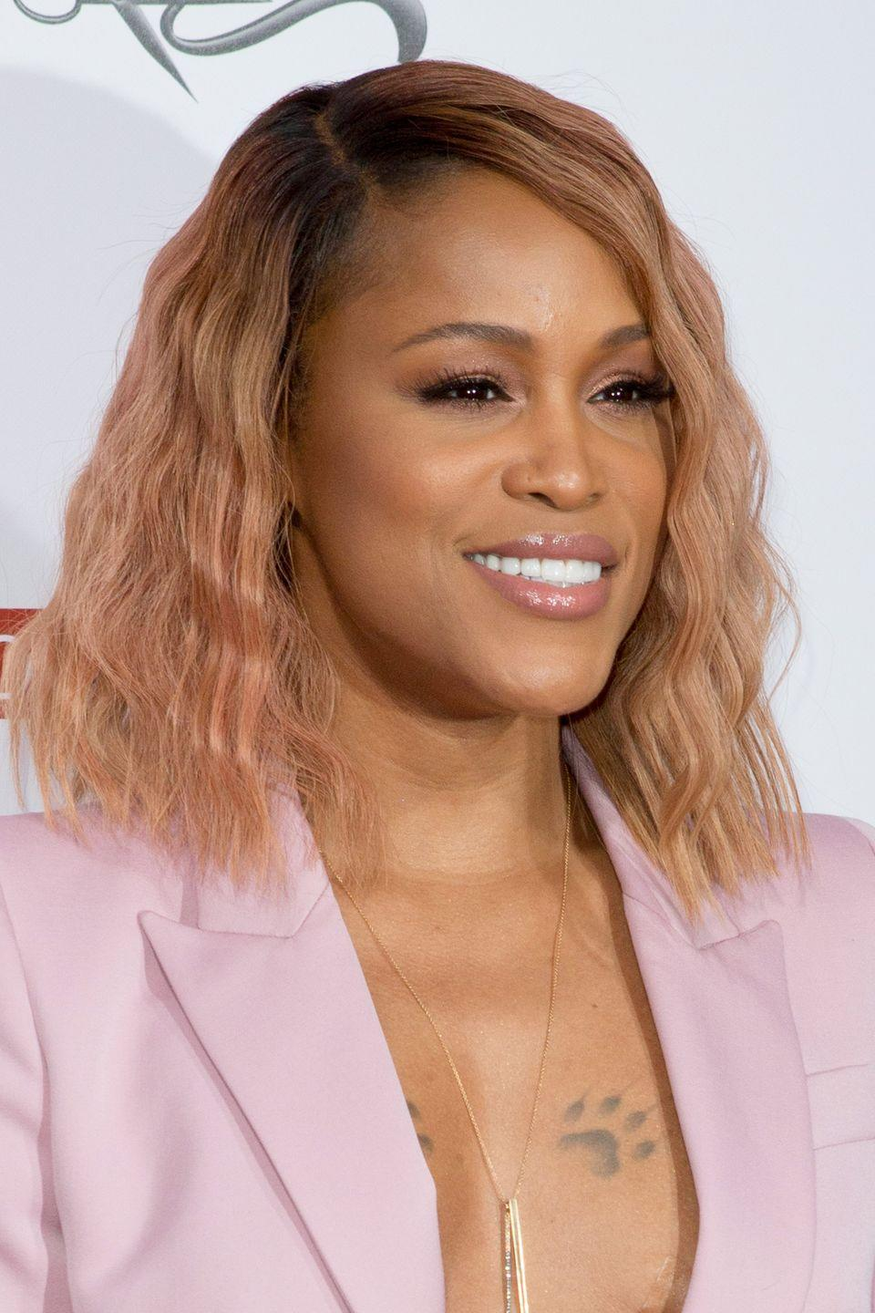 """<p>Eve is known for her blonde hair, but she mixed things up in 2016 with a softer, more adventurous shade.</p><p>""""Brown-skinned women with neutral undertones look fabulous with rosy-gold highlights,"""" says <a href=""""https://www.instagram.com/yourhairsbestfriend/"""" rel=""""nofollow noopener"""" target=""""_blank"""" data-ylk=""""slk:Chereen Monet"""" class=""""link rapid-noclick-resp"""">Chereen Monet</a>, a NYC-based master colorist who specializes in textured hair. """"It brings out the natural bronze of the skin.""""</p>"""