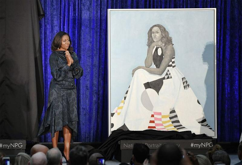Former first lady Michelle Obama stands next to her Smithsonian portrait, painted by Amy Sherald. | Olivier Douliery/ABACA USA/INSTARimages.com