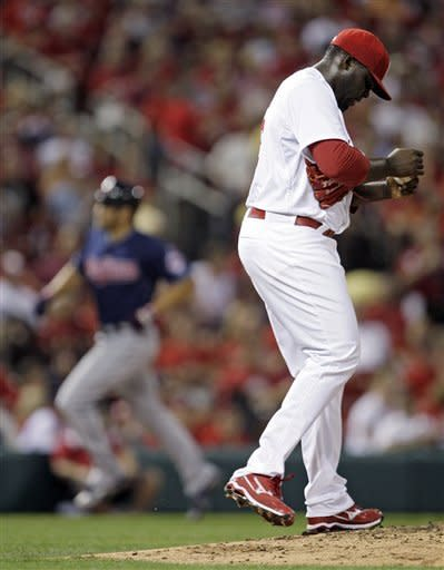 St. Louis Cardinals relief pitcher Maikel Cleto regroups as Cleveland Indians' Johnny Damon circles the bases after hitting a two-run home run in the seventh inning of a baseball game, Friday, June 8, 2012 in St. Louis. (AP Photo/Tom Gannam)