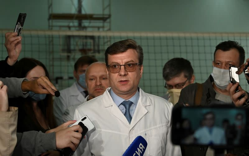 FILE PHOTO: Alexander Murakhovsky, chief doctor of a hospital, where Alexei receives medical treatment, speaks with the media in Omsk
