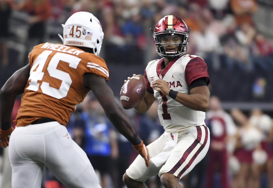 Did Oklahoma quarterback Kyler Murray (1) do enough in the Big 12 title game to pass Tua Tagovailoa on Heisman ballots? (AP)