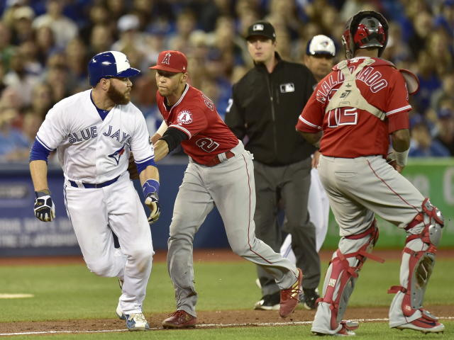 Toronto Blue Jays' Russell Martin (55) is tagged out by Los Angeles Angels shortstop Andrelton Simmons (2) as he is caught in a rundown during the fourth inning of a baseball game Tuesday, May 22, 2018, in Toronto. (Frank Gunn/The Canadian Press via AP)