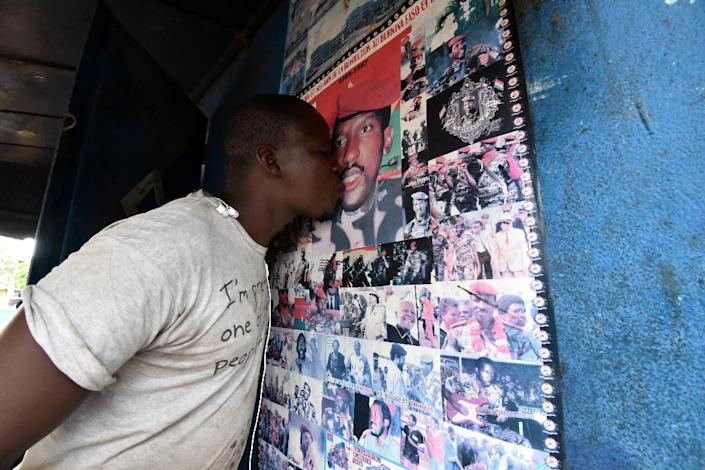 Sankara remains hugely popular 30 years after his death -- here, a supporter in Abidjan's Marcory district kisses a portrait of him (AFP Photo/Sia KAMBOU)