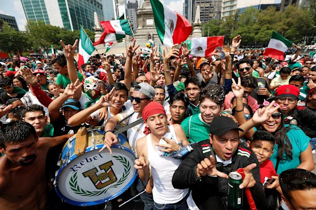 Soccer Football - FIFA World Cup - Group F - South Korea v Mexico - Mexico City, Mexico - June 23, 2018 - Mexican fans celebrate at the Angel of Independence monument. REUTERS/Gustavo Graf