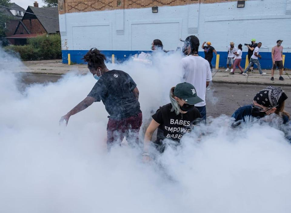 """<div class=""""inline-image__caption""""><p>Detroit police use tear gas on protesters following the shooting death of a suspect at the hands of officers last summer.</p></div> <div class=""""inline-image__credit"""">Seth Herald/AFP via Getty</div>"""