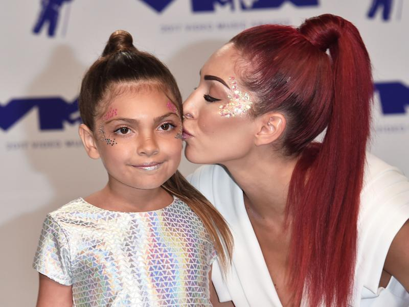 Farrah Abraham kisses Sophia at an event