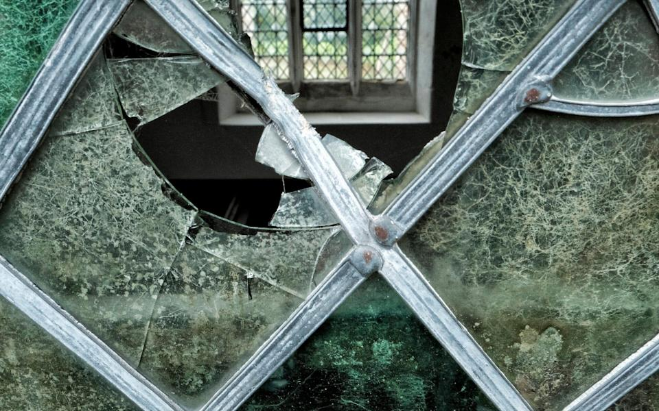 Vandals smashed windows at the medieval church - John Robertson for The Telegraph