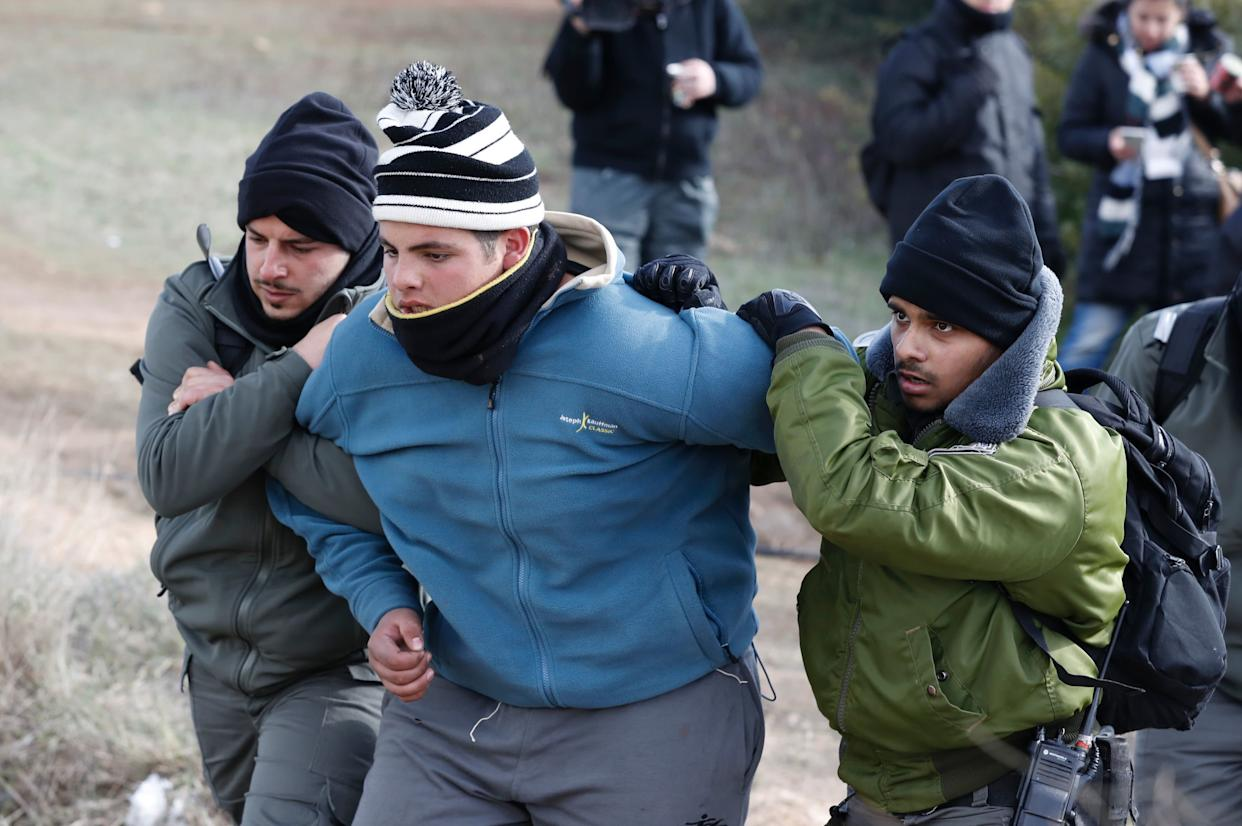 An Israeli settler is evicted by security forces at the Amona outpost.