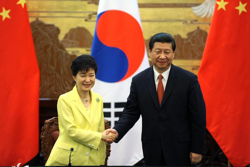 South Korean President Park Geun-hye, left, shakes hands with Chinese President Xi Jinping after a joint declaration ceremony at the Great Hall of the People in Beijing Thursday, June 27, 2013. The Chinese and South Korean presidents reaffirmed close ties between their nations Thursday at a Beijing summit that brings together North Korea's archrival and its biggest ally, ratcheting up pressure on Pyongyang to rejoin nuclear disarmament talks. (AP Photo/Wang Zhao, Pool)