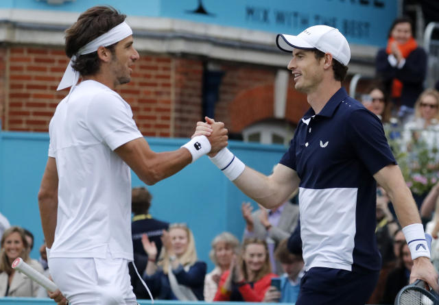 Andy Murray of Britain celebrates with Feliciano Lopez of Spain winning their doubles match against Juan Sebastian Cabal and Robert Farah of Colombia at the Queens Club tennis tournament in London, Thursday, June 20, 2019.(AP Photo/Frank Augstein)