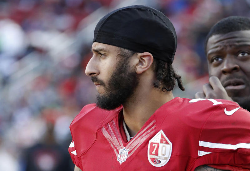 FILE - In this Jan. 1, 2017 file photo San Francisco 49ers quarterback Colin Kaepernick stands on the sideline during an NFL football game in Santa Clara, Calif. Wisconsin Gov. Scott Walker sent a letter Monday Oct. 16, 2017 to NFL Commissioner Roger Goodell and Players Association Executive Director DeMaurice Smith saying he believes players are showing disrespect for the flag and veterans. Former 49ers quarterback Colin Kaepernick started the protests last season when he refused to stand during the anthem to protest racial inequality and police brutality. (AP Photo/Tony Avelar File)