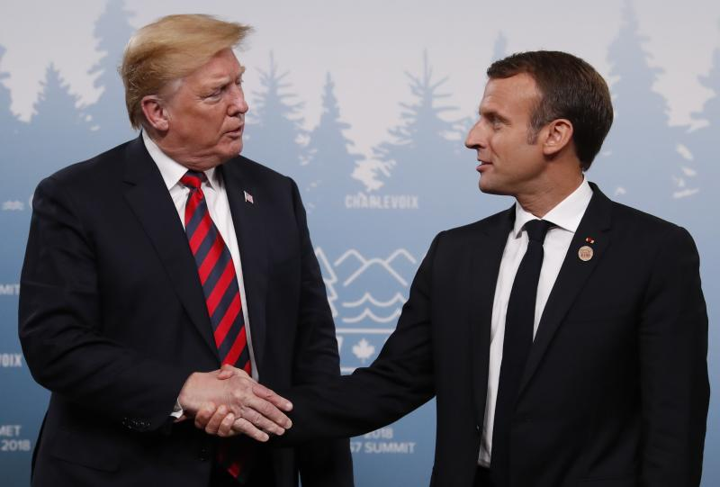 Trump shakes hands with France's President Emmanuel Macron during a bilateral meeting at the G-7 summit on Friday. (Leah Millis / Reuters)