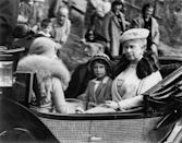 <p>Princess Elizabeth accompanies King George V and Queen Mary to a church service at Crathie, near Balmoral. </p>