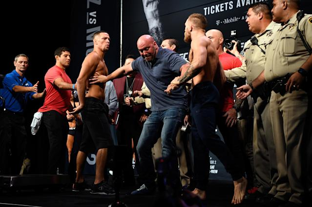 <p>Here's where McGregor solidified his superstar status: Unlike fellow star Ronda Rousey, who disappeared after losing to Holm at the height of her fame and lost touch with her fanbase, McGregor demanded an immediate rematch, and Diaz, who had received far and away the biggest payday of his life for the first fight, certainly didn't object. The duo were slated to meet again at UFC 200 … until McGregor and the UFC got into a dispute over media obligations, whereupon the UFC yanked the fight and McGregor announced his retirement. Cooler heads eventually prevailed, and McGregor eked out a majority-decision victory in a barnburner of a five-round fight at UFC 202 in Las Vegas. Diaz-McGregor 2 did 1.65 million buys, which still sits as the company record. </p>