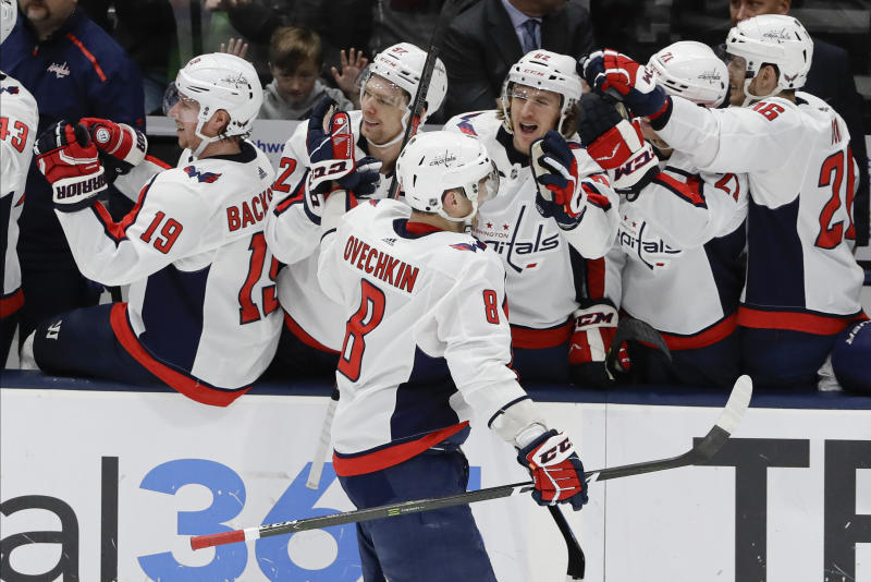 Washington Capitals' Alex Ovechkin (8) celebrates with teammates after scoring during the third period of an NHL hockey game against the New York Islanders Saturday, Jan. 18, 2020, in Uniondale, N.Y. The Capitals won 6-4. (AP Photo/Frank Franklin II)
