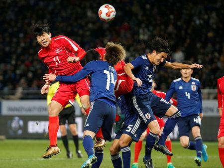 Soccer Football - East Asian Football Championship - North Korea v Japan - Ajinomoto Stadium, Tokyo, Japan - December 9, 2017. North Korea's Jong Il Gwan and Japan's Junya Ito and Mu Kanazaki in action. REUTERS/Toru Hanai