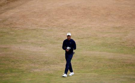 British Open: Tiger Woods stumbles late, battles to even-par 71