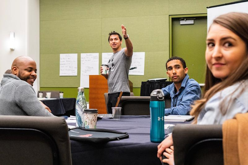 Arena co-founder Ravi Gupta, center, at an Arena Academy session in Des Moines. (Photo: Lee Pedinoff)