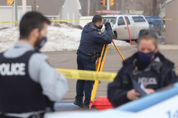 RCMP officers are shown at the scene on Friday morning.