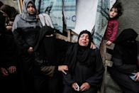 Relatives of a Palestinian killed during clashes with Israeli forces mourn during his funeral in the Gaza Strip on April 6, 2018