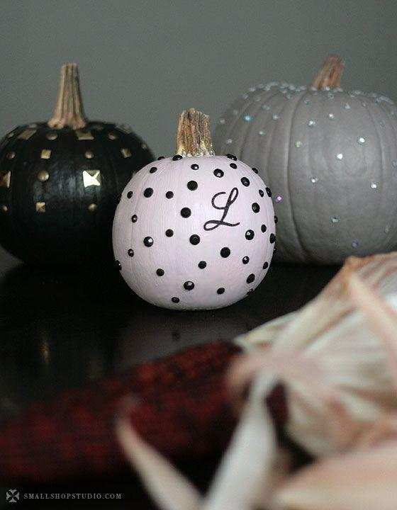 """<p>With stick-on gems and studs over solid gray, white, and black pumpkins, these quick designs will add a modern touch to your home.</p><p><strong><em>Get the tutorial from <a href=""""http://erikabrechtel.com/2012/10/22/d-i-y-edgy-chic-pumpkins/"""" rel=""""nofollow noopener"""" target=""""_blank"""" data-ylk=""""slk:Erika Brechtel"""" class=""""link rapid-noclick-resp"""">Erika Brechtel</a>.</em> </strong></p>"""