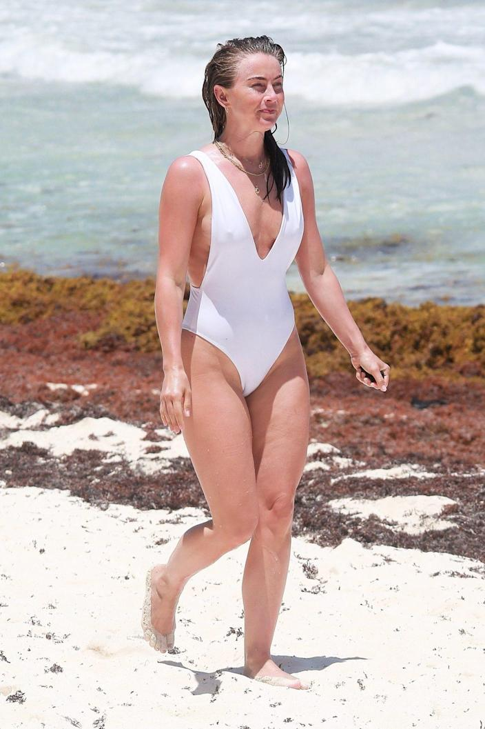 <p>Julianne Hough takes a seaside stroll while on vacation in Tulum, Mexico on Thursday.</p>