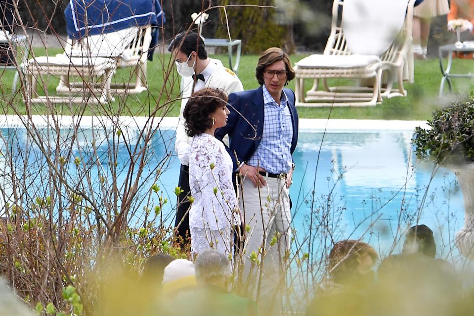 Who doesn't love a movie pool party? (Answer: the husband-and-wife fashion magnates with a troubled relationship that ends in assassination.)