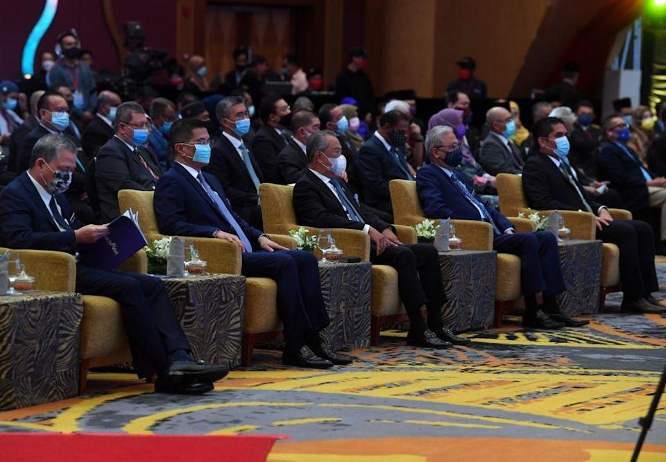 Prime Minister Tan Sri Muhyiddin Yassin (third from left) attends a Malaysia Prihatin event at the Putrajaya International Convention Centre March 1, 2020. — Bernama pic