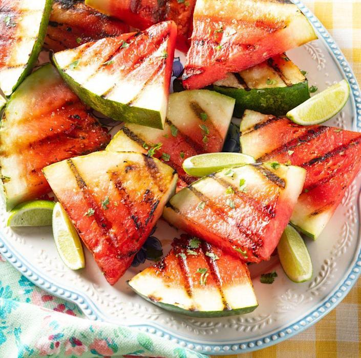 """<p>Watermelon doesn't have to just be for dessert this year. Instead, try a sweet and savory version on the grill. It's seasoned with salt, lime, and cilantro for a fun twist on everyone's favorite summer fruit. </p><p><a href=""""https://www.thepioneerwoman.com/food-cooking/recipes/a35936464/grilled-watermelon/"""" rel=""""nofollow noopener"""" target=""""_blank"""" data-ylk=""""slk:Get the recipe."""" class=""""link rapid-noclick-resp""""><strong>Get the recipe. </strong></a></p><p><a class=""""link rapid-noclick-resp"""" href=""""https://go.redirectingat.com?id=74968X1596630&url=https%3A%2F%2Fwww.walmart.com%2Fsearch%2F%3Fquery%3Dgrill%2Btools&sref=https%3A%2F%2Fwww.thepioneerwoman.com%2Ffood-cooking%2Fmeals-menus%2Fg36353420%2Ffourth-of-july-side-dishes%2F"""" rel=""""nofollow noopener"""" target=""""_blank"""" data-ylk=""""slk:SHOP GRILL TOOLS"""">SHOP GRILL TOOLS</a></p>"""