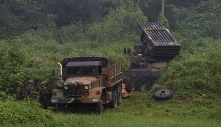 A South Korean army's Multiple Launch Rocket System (MLRS) (R) is deployed just south of the demilitarized zone separating the two Koreas in Yeoncheon, South Korea, August 23, 2015. REUTERS/Lim Byung-sik/Yonhap