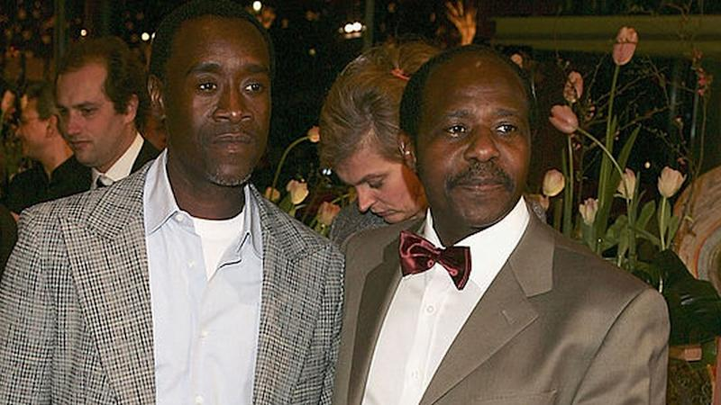 "Actor Don Cheadle (L) and Paul Rusesabagina arrive at the ""Hotel Rwanda"" Premiere during the 55th annual Berlinale International Film Festival on February 11, 2005 in Berlin, Germany."