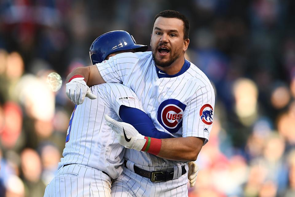 Kyle Schwarber of the Chicago Cubs had to be restrained after disagreeing with umpire Gabe Morales. (Photo by Stacy Revere/Getty Images)