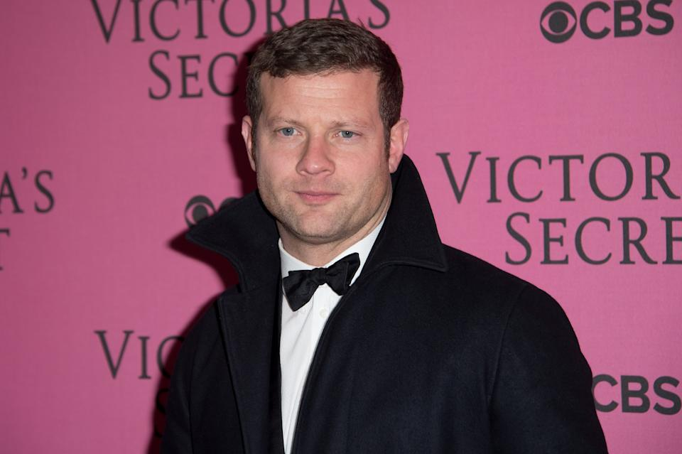 Dermot O'Leary poses for photographers upon arrival at the Victoria's Secret fashion show in London, Tuesday, Dec. 2, 2014. (Photo by Jonathan Short/Invision/AP)