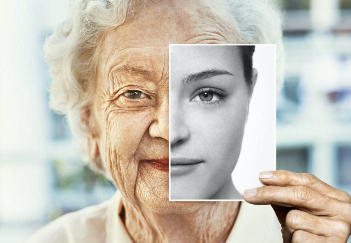 """<span class=""""caption"""">Is there a genetic switch that can help reverse the aging process?</span> <span class=""""attribution""""><a class=""""link rapid-noclick-resp"""" href=""""https://www.gettyimages.com/detail/photo/portrait-of-woman-holding-black-and-white-younger-royalty-free-image/1149473225?adppopup=true"""" rel=""""nofollow noopener"""" target=""""_blank"""" data-ylk=""""slk:Dimitri Otis / Getty Images"""">Dimitri Otis / Getty Images</a></span>"""