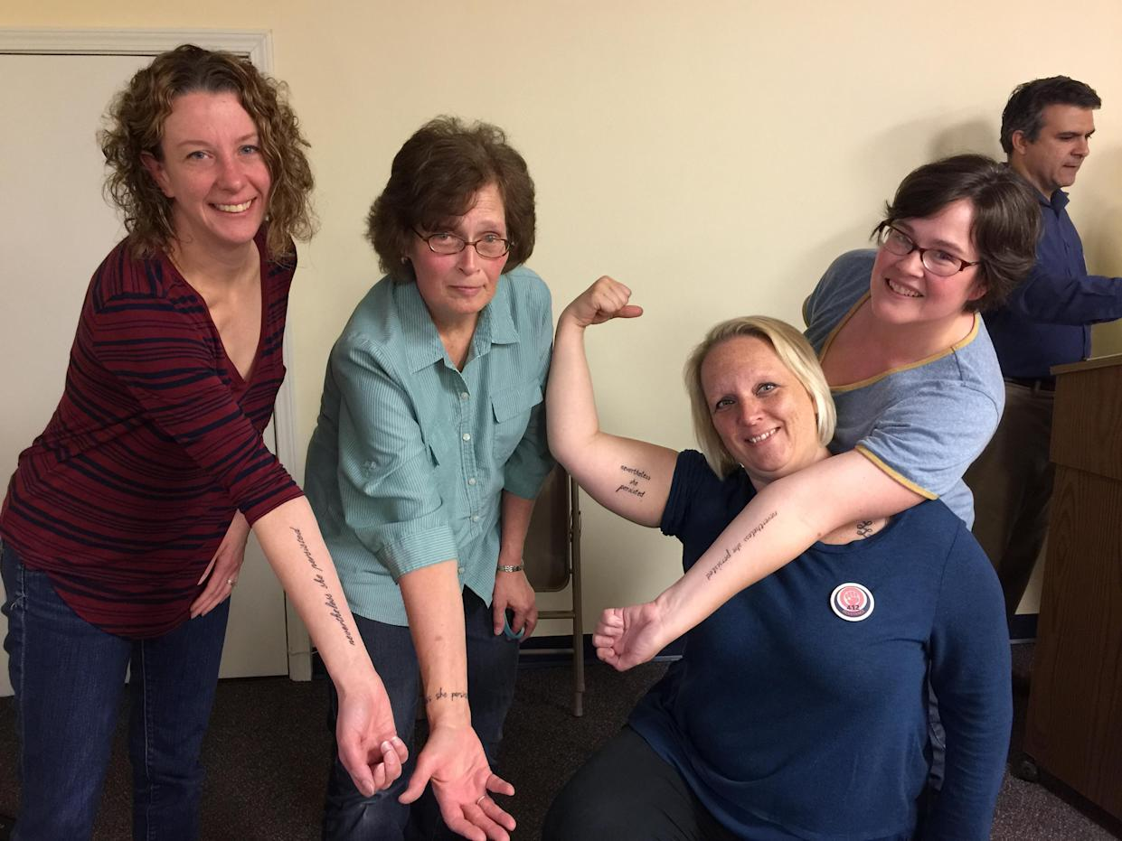 Nevertheless they persisted: Four members of 412 Resistance, including Valerie Fleisher, right, and Lara Huber, second from right, show off their tattoos. In the spring of 2017, the group hosted a fundraiser in Pittsburgh where women got tattoos of Senate Majority Leader Mitch McConnell's words, which have become a feminist rallying cry. (Photo: Garance Franke-Ruta/Yahoo News)