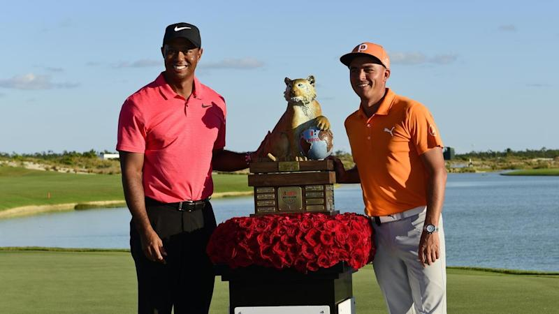 Rickie Fowler with Tiger Woods after winning the World Challenge golf event in the Bahamas